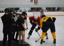 Connor Radley drops the puck at the start of the Alex Tuch 3 on 3 Pro Hockey Game to benefit Maureen's Hope Foundation.
